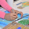 Student working on Kids With Food Allergies mosaic