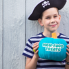 Teal pumpkin for a food allergy friendly Halloween: Child holding a teal pumpkin for a food allergy friendly Halloween