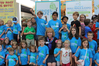 lynda-mitchell-surrounded-by-kids-strides-for-safe-kids-kids-with-food-allergies.png